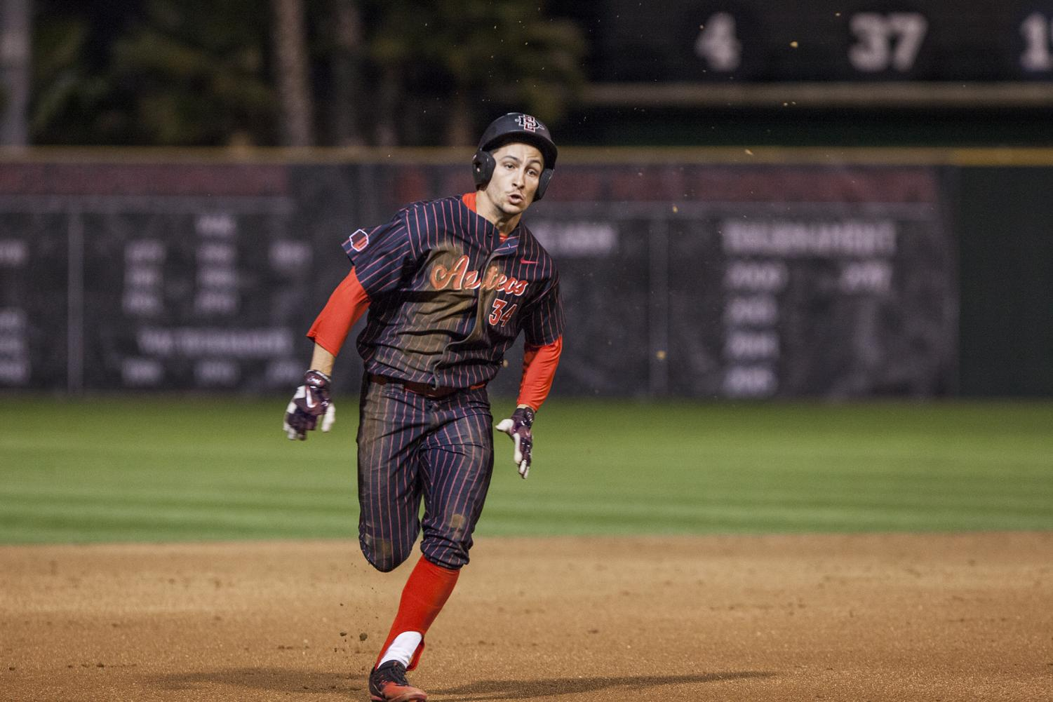Senior outfielder Chase Calabuig runs the bases during the Aztecs 9-1 victory over UCSB on Feb. 16 at Tony Gwynn Stadium.