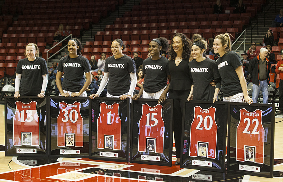 (Left to Right) Allison Brown, Cheyenne Greenhouse, Khalia Lark, McKynzie Fort, head coach Stacie Terry, Geena Gomez and Lexy Thorderson stand with individualized plaques during a pre-game ceremony honoring the team's senior players at Viejas Arena on Feb. 24.