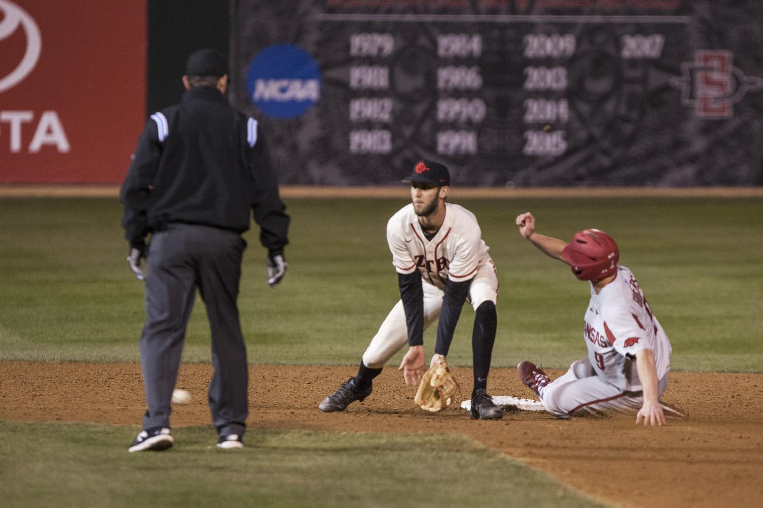 Arkansas junior shortstop Jax Biggers beats the throw to second base during the Aztecs 5-2 loss to the No. 4 Razorbacks on Feb. 24 at Tony Gwynn Stadium.