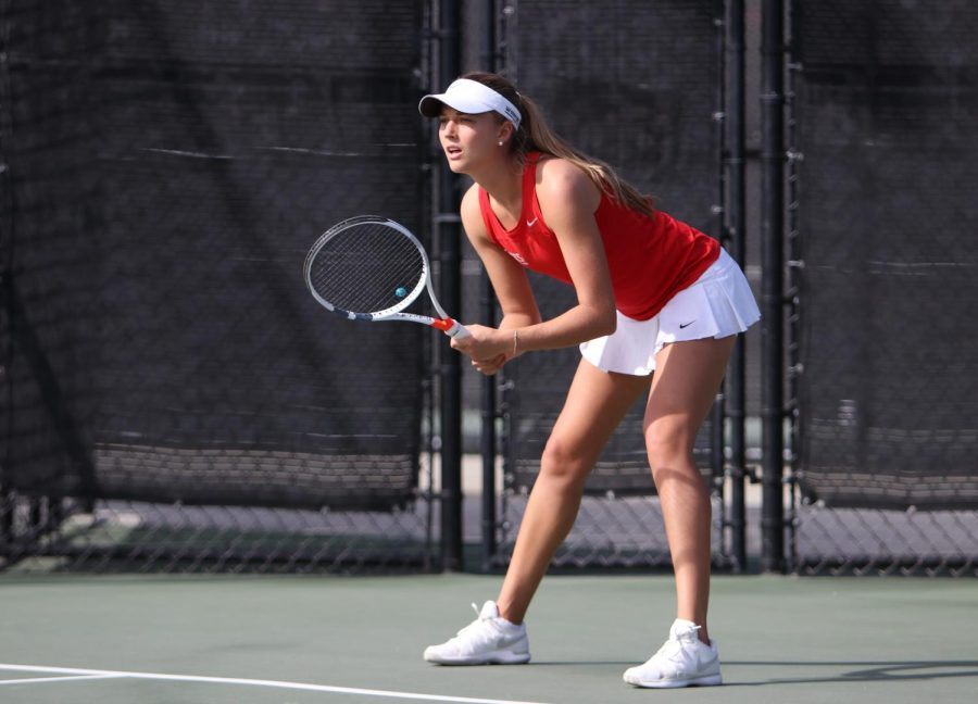 Senior+tennis+player+Jana+Buth+prepares+to+return+service+during+a+match+against+UCSD+on+Jan.+27