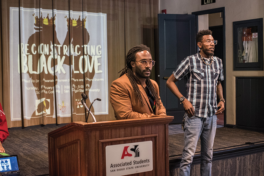 Marriage and family therapy trainee Dwayne Shavers, along with youth advocate Donald Barksdale, address students inside Scripps Cottage for a Reconstructing Black Love forum on Feb. 15.