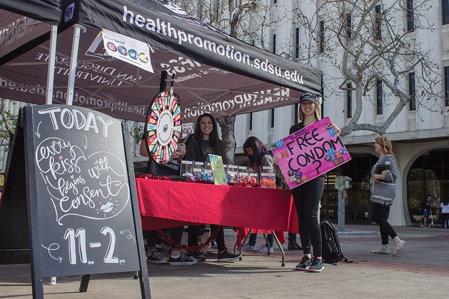 Public health senior Angelica Cortez (left) and public health graduate student Jamie Harness (right) worked the