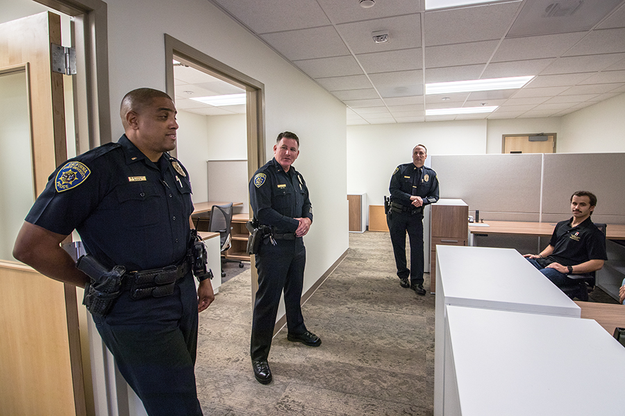 From left to right: SDSUPD Lts. Ronald Broussard, Matthew Conlon and Chuck Kaye, along with Ryan Janics, a student inspection assistant for the Office of Housing Administration, at the police department's new substation Monday.