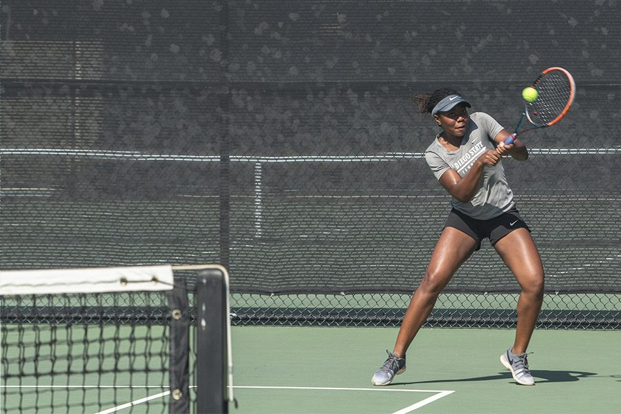 Freshman+Nnena+Nadozie+hits+the+ball+during+a+home+doubles+match+against+USD+on+Feb.+11.+The+Aztecs+lost+the+overall+match+by+a+score+of+4-2.+