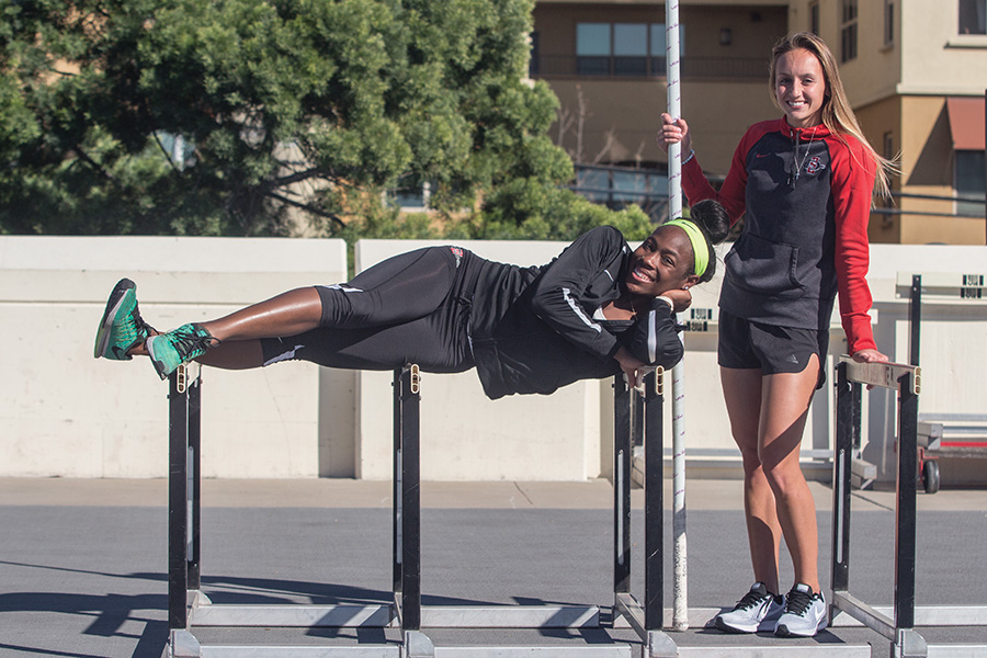 Senior Ashley Henderson (left) and redshirt junior Bonnie Draxler pose after practice on Feb. 16 at the Aztecs Sports Deck.