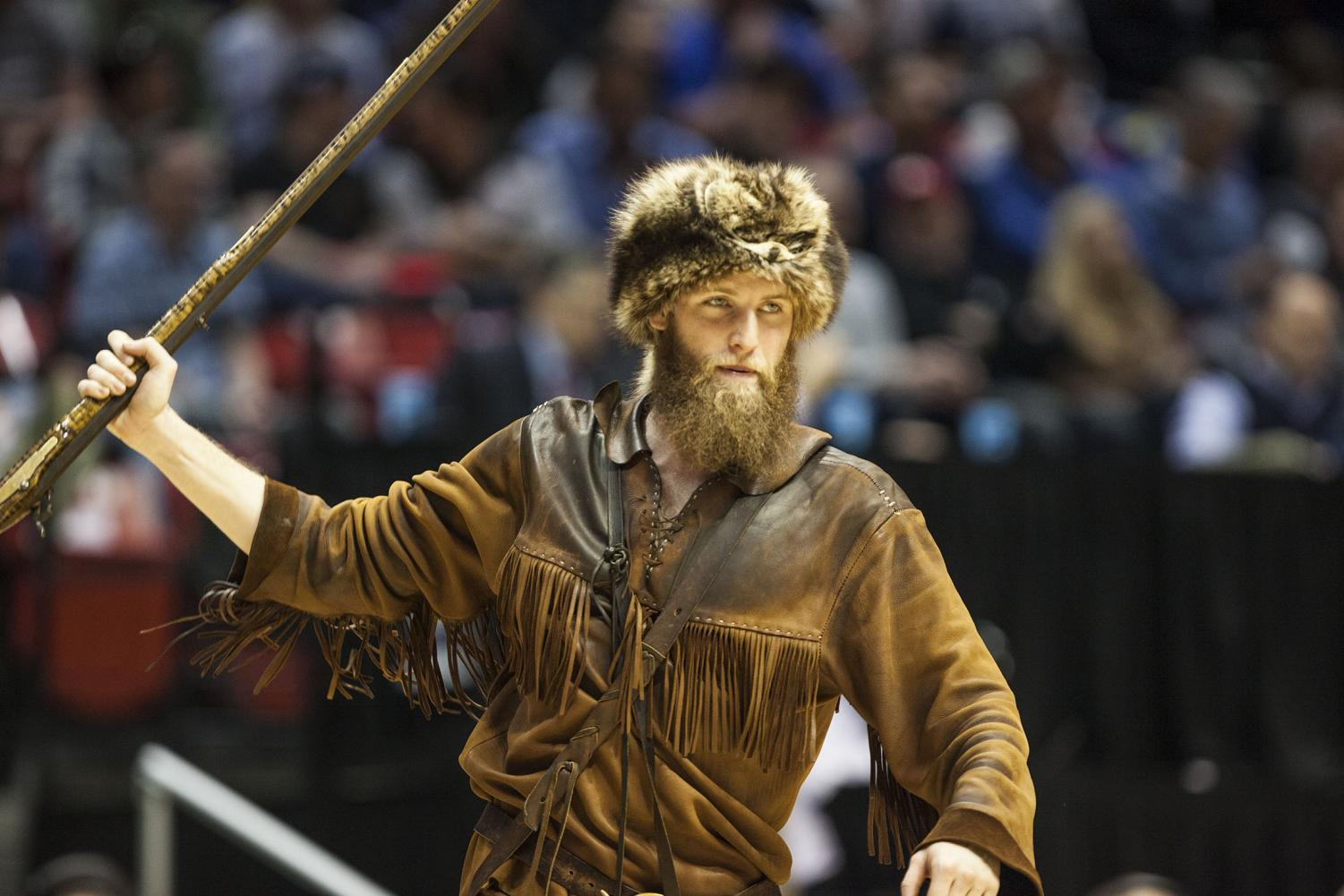 The West Virginia Mountaineer holds up his musket during West Virginia's 85-68 victory over Murray State on March 16 at Viejas Arena.