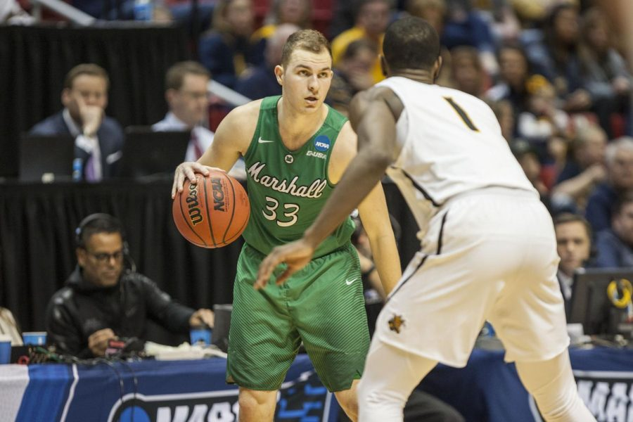 Jon Elmore carries the ball during Marshall's 81-75 victory over Wichita State on March 16 at Viejas Arena.