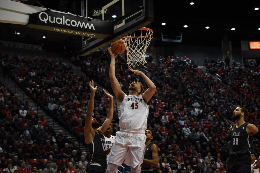 Senior+center+Kameron+Rooks+goes+up+for+a+layup+during+the+Aztecs+79-74+victory+over+No.+21+Nevada+on+March+3+at+Viejas+Arena