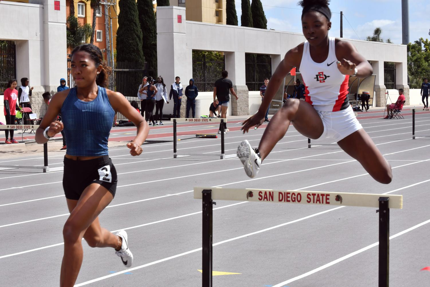 Jasmine Young competes during the 400-meter hurdles during the Aztec Invitational at the Aztrack Sports Deck on March 24.