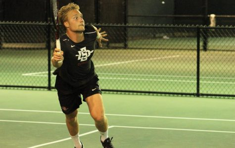 Sophomore Joel Popov competes on the court during the Aztecs 5-2 loss to Liberty on March 21 at the Aztec Tennis Center.