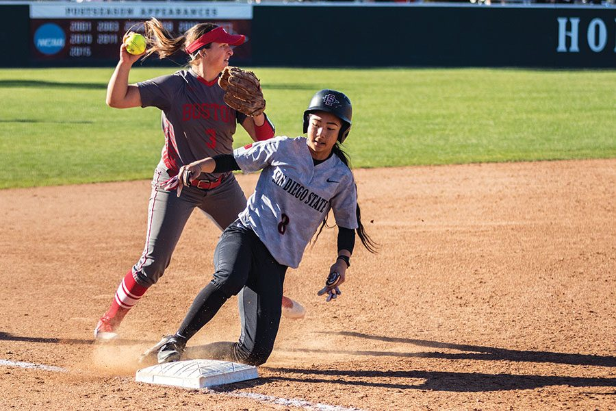 Freshman+outfielder+Janina+Jusay+slides+into+third+base+during+the+Aztecs+1-0+loss+to+Boston+University+on+March+4+at+SDSU+Softball+Stadium.+
