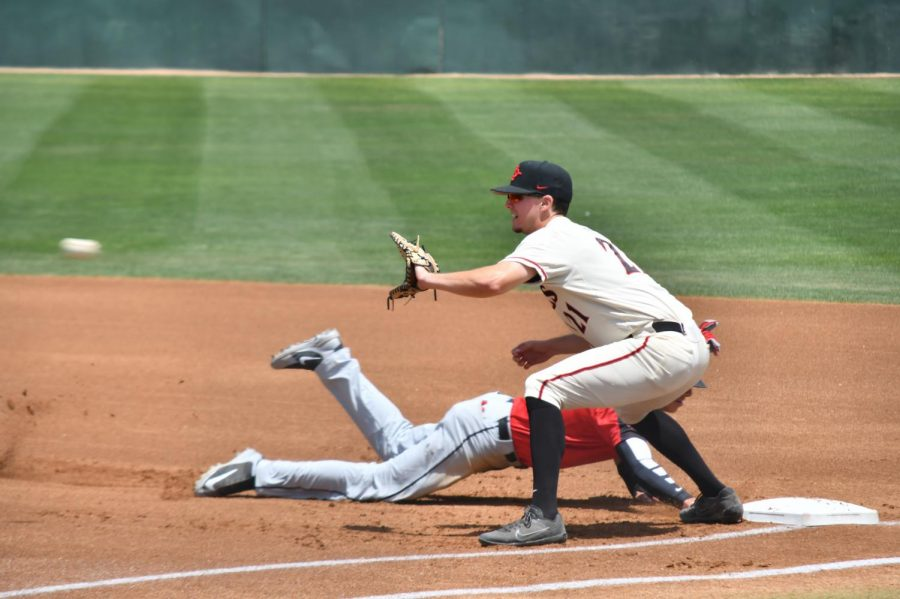 Junior first baseman Jordan Verdon attempts to pick off UNLV's Bryson Stott during the Aztecs 4-2 victory over the Rebels on April 29 at Tony Gwynn Stadium.
