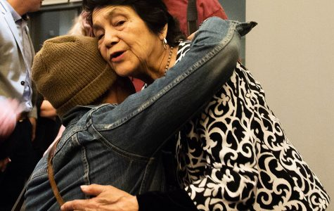 Labor activist Dolores Huerta embraces an attendee at her talk on UC San Diego's campus.