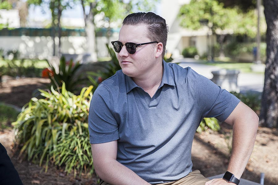 Brandon Jones, now-former president of SDSU College Republicans, near the Education and Business Administration building on April 23.