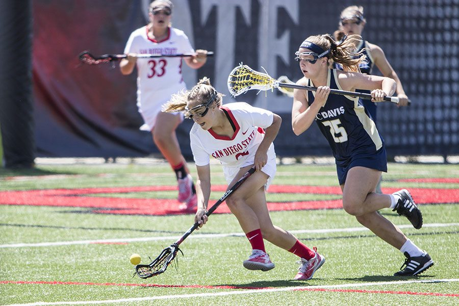 Then-freshman Julia Sheehan goes for the ball during the Aztecs' 15-9 loss to UC Davis at the Aztec Lacrosse Field on April 8, 2018.