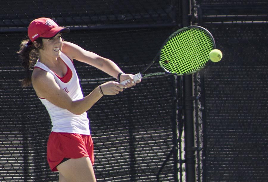 Freshman+Abbie+Mulbarger+swings+her+racket+during+the+Aztecs+4-1+victory+over+San+Francisco+at+Aztec+Tennis+Center+on+April+8.