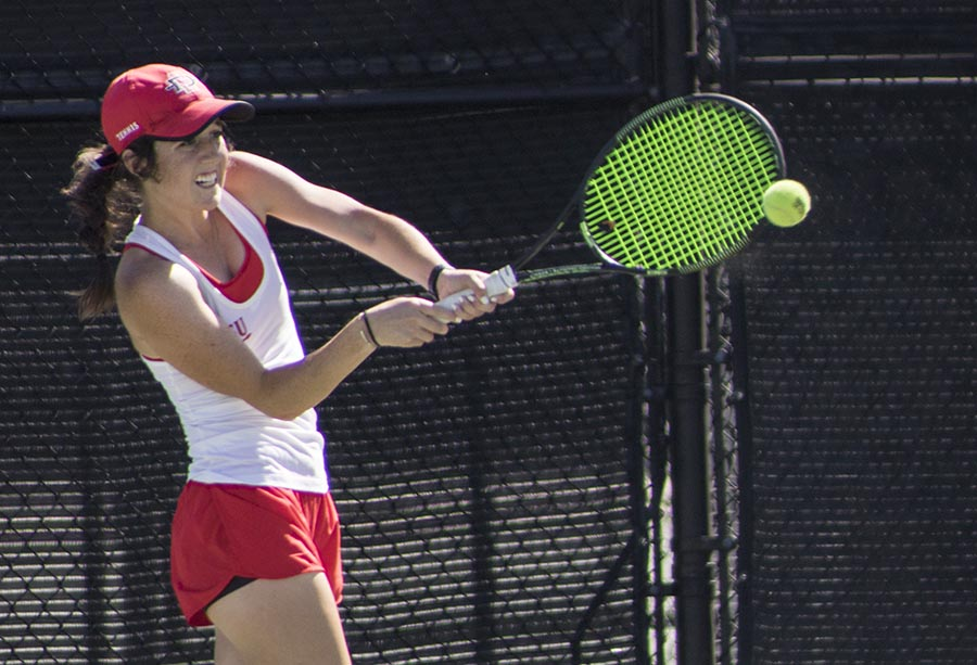 Freshman Abbie Mulbarger swings her racket during the Aztecs 4-1 victory over San Francisco at Aztec Tennis Center on April 8.