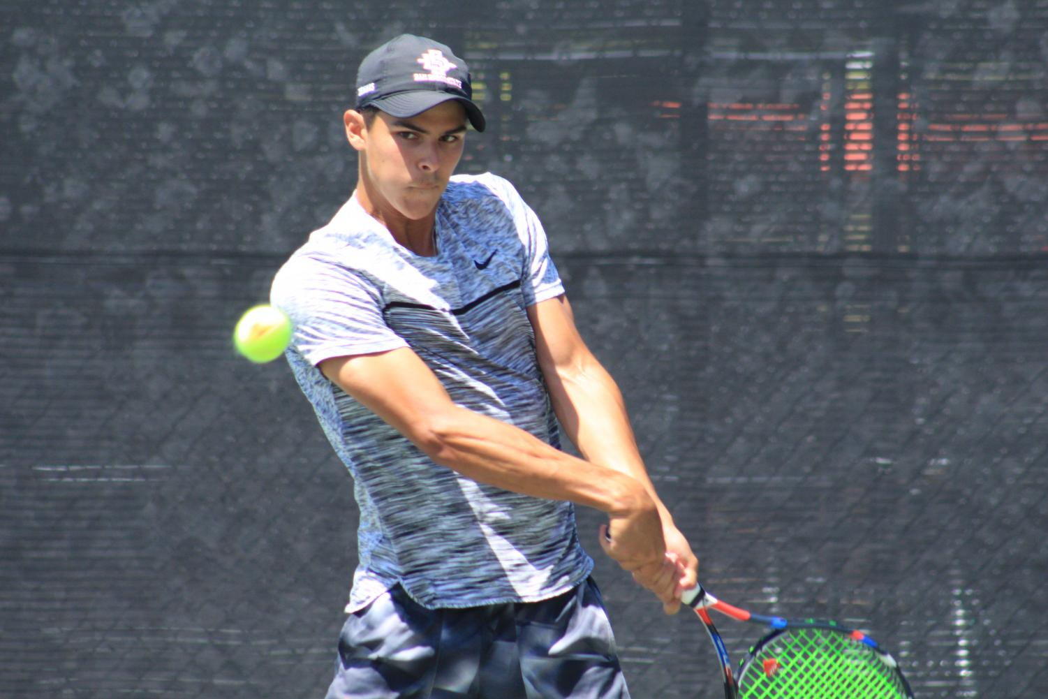 Freshman Ignacio Martinez readies to hit the ball during the Aztecs 4-0 victory over Air Force at the Aztec Tennis Center on April 8.
