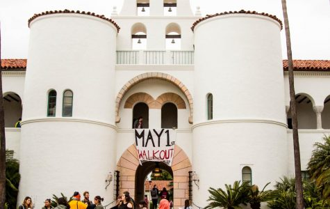 Students prepare for a demonstration on May 1, in front of Hepner Hall to advocate for better on campus living wages and other issues.