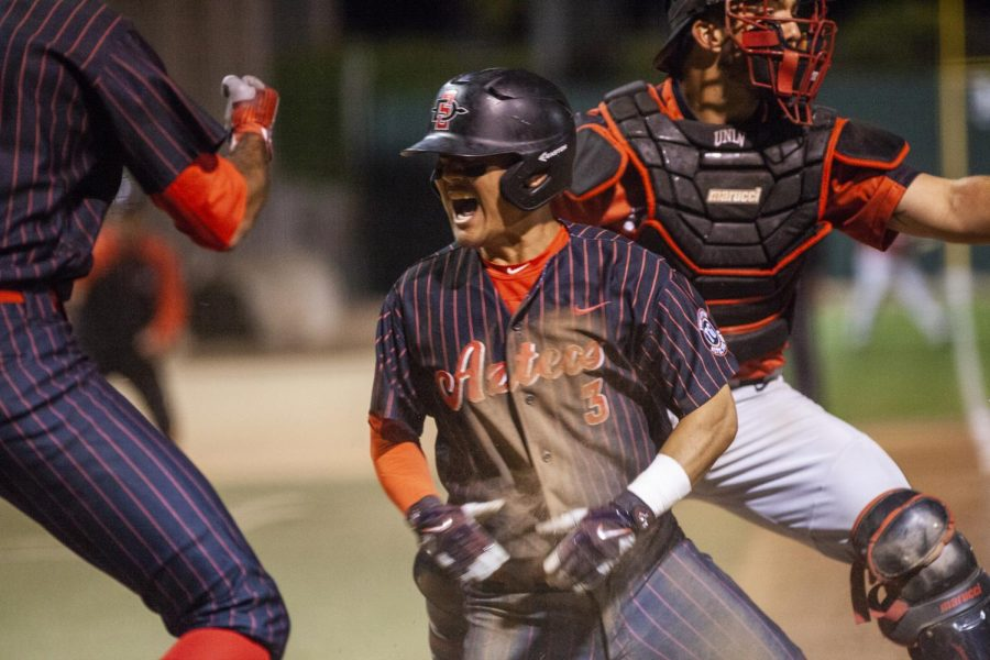 Sophomore second baseman Jacob Maekawa celebrates after scoring the game-winning run during the Aztecs 4-3 victory over UNLV on May 25 at Tony Gwynn Stadium.