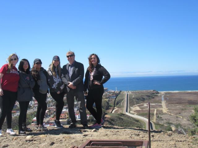 SDSU+students+pose+with+a+Border+Patrol+union+representative+pose+near+the+Tijuana+River+Valley.+From+left+to+right%3A+Anna+Waletzko%2C+Bo+Chen-Samuel%2C+Paige+McParland%2C+Amanda+Enriquez%2C+Border+Patrol+union+representative+Christopher+Harris+and+student+Jerralyn+Belinda.+Photo+courtesy+of+Anna+Waletzko.