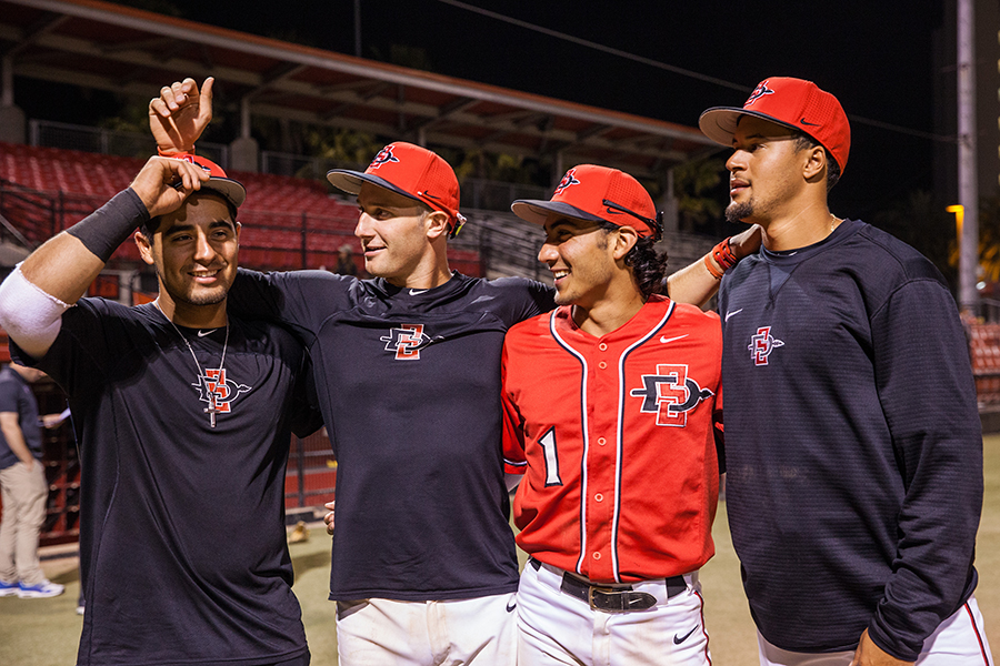 (left to right) Junior Dean Nevarez, freshman Casey Schmitt, sophomore Julian Escobedo and sophomore Tre Brown horse around after the Aztecs game on April 28 at Tony Gwynn Stadium.