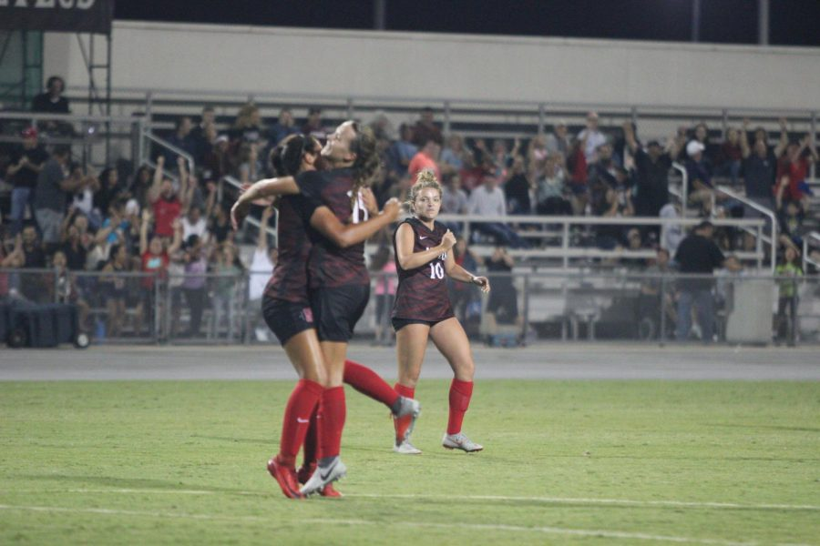 Freshman forward Taylor Moorehead (left) celebrates with sophomore midfielder Daniela Filipovic (middle) as senior midfielder Nikolina Musto (right) looks on after Moorehead scored the game winning goal during the Aztecs 1-0 victory over New Mexico State on Aug. 17 at the SDSU Sports Deck.
