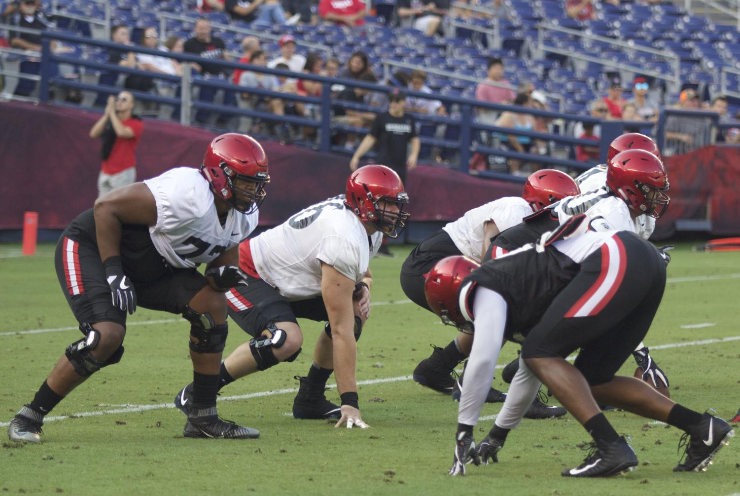 Offensive line scrimmages at the annual Fan Fest at SDCCU Stadium on Aug. 18.