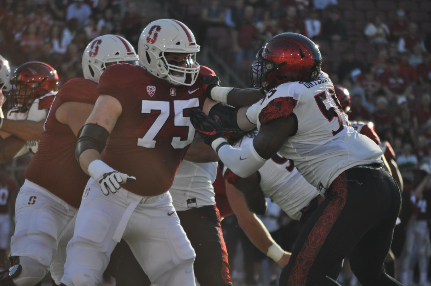 SDSU senior defensive lineman Chibu Onyeukwu battles Stanford offensive lineman A.T. Hall during SDSU's 31-10 road loss against Stanford on Aug. 31.