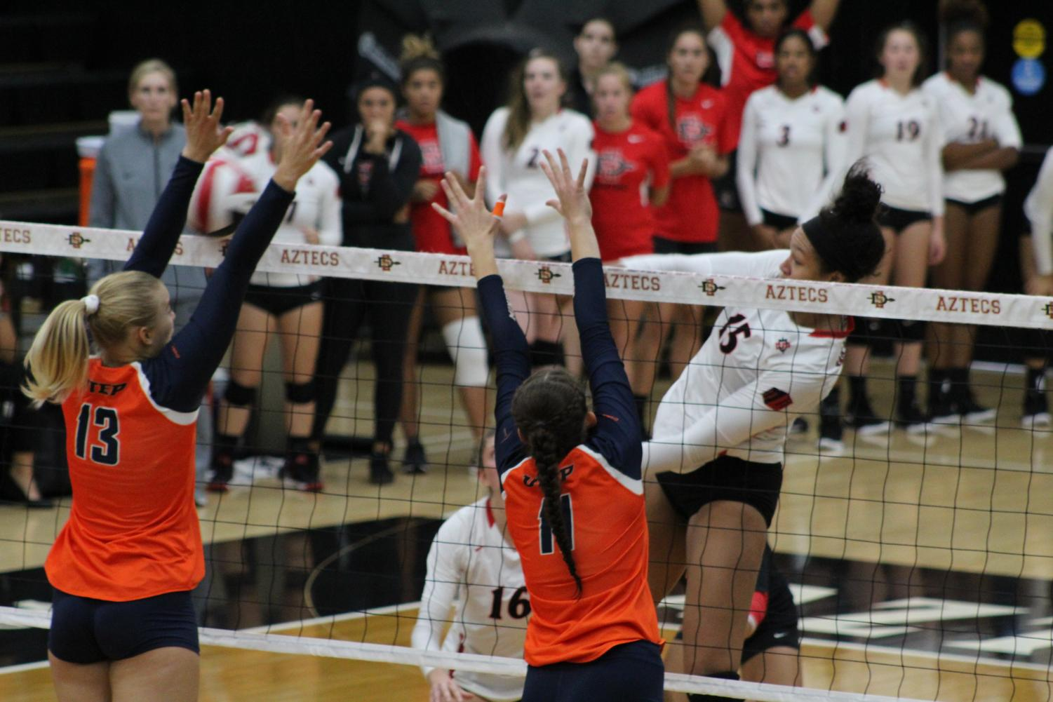 Senior middle blocker Deja Harris follows through after spiking the ball during the Aztecs five-set loss to UTEP on Sept. 15 at Peterson Gym.