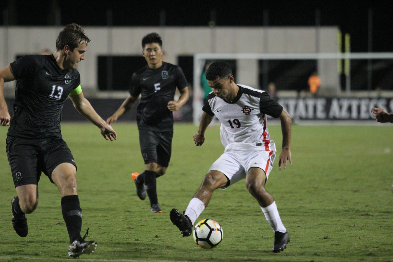 Senior forward Damian German dribbles the ball during the Aztecs 2-0 victory over Brown University on Sept. 14 at the SDSU Sports Deck. German had two goals in the game.