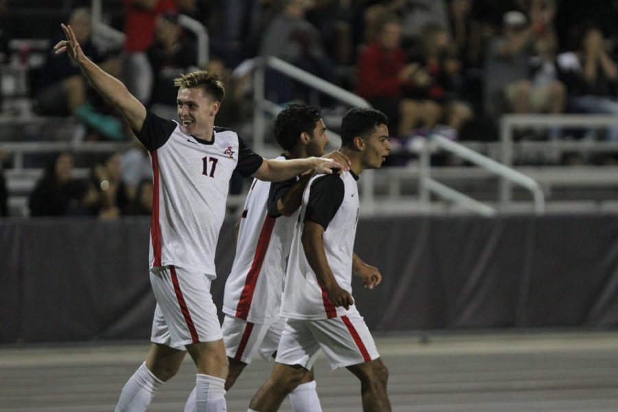 Redshirt-freshman+midfielder+Reagan+Sherlock+%28left%29+celebrates+with+junior+midfielder+Spencer+Madden+%28middle%29+and+senior+forward+Damian+German+%28right%29+during+the+Aztecs+2-0+victory+over+Brown+on+Sept.+15+at+the+SDSU+Sports+Deck.+German+had+two+goals+during+the+match.+