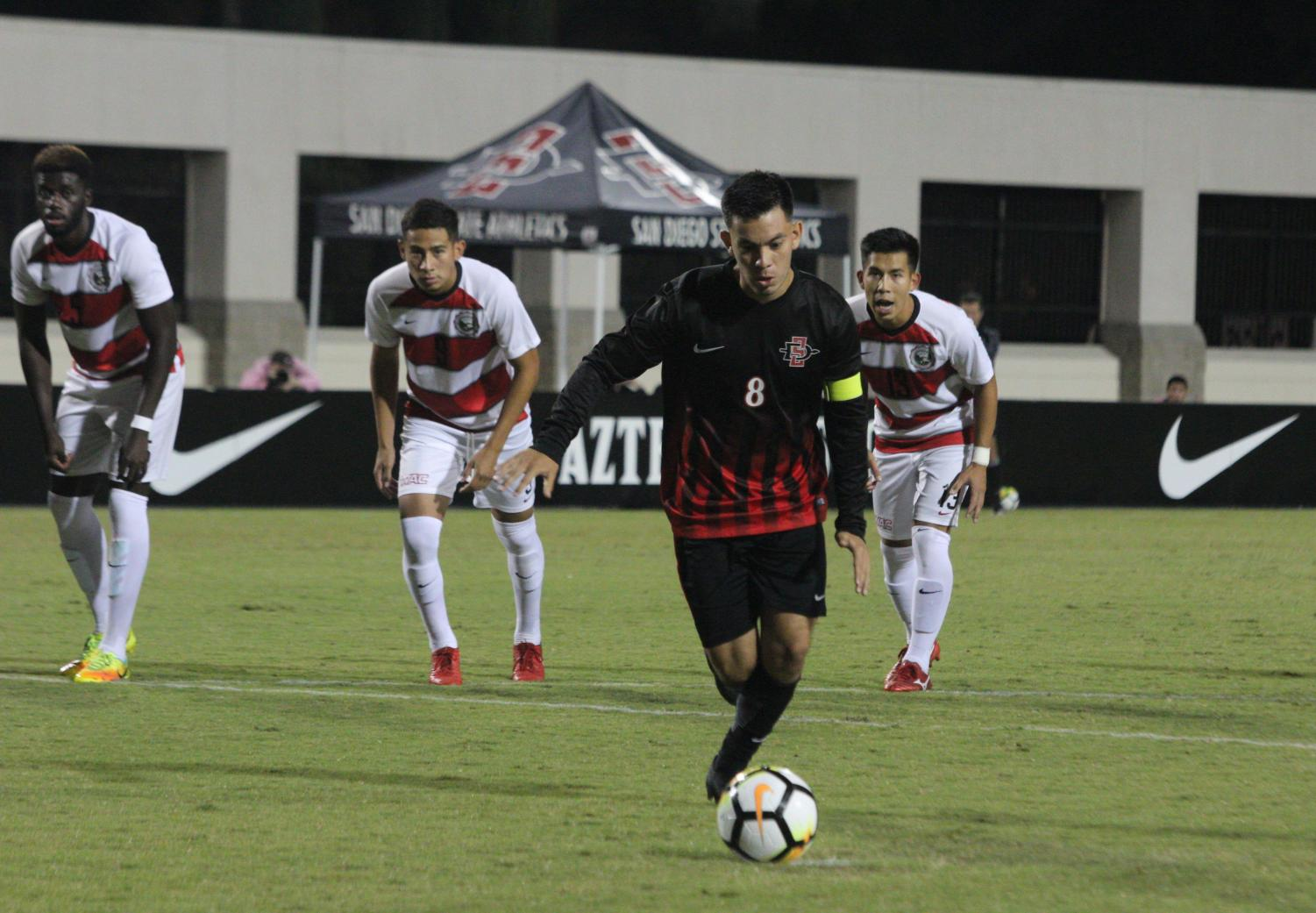 Junior midfielder Pablo Pelaez lines up for a kick during the Aztecs 2-1 victory over UNLV on Sept. 24 at the SDSU Sports Deck.