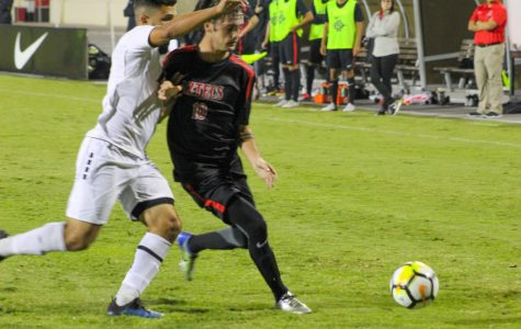 Redshirt sophomore midfielder Keegan Kelly attempts to maintain possession of the ball during the Aztecs 2-1 victory over LIU Brooklyn on Sept. 7 at the SDSU Sports Deck.