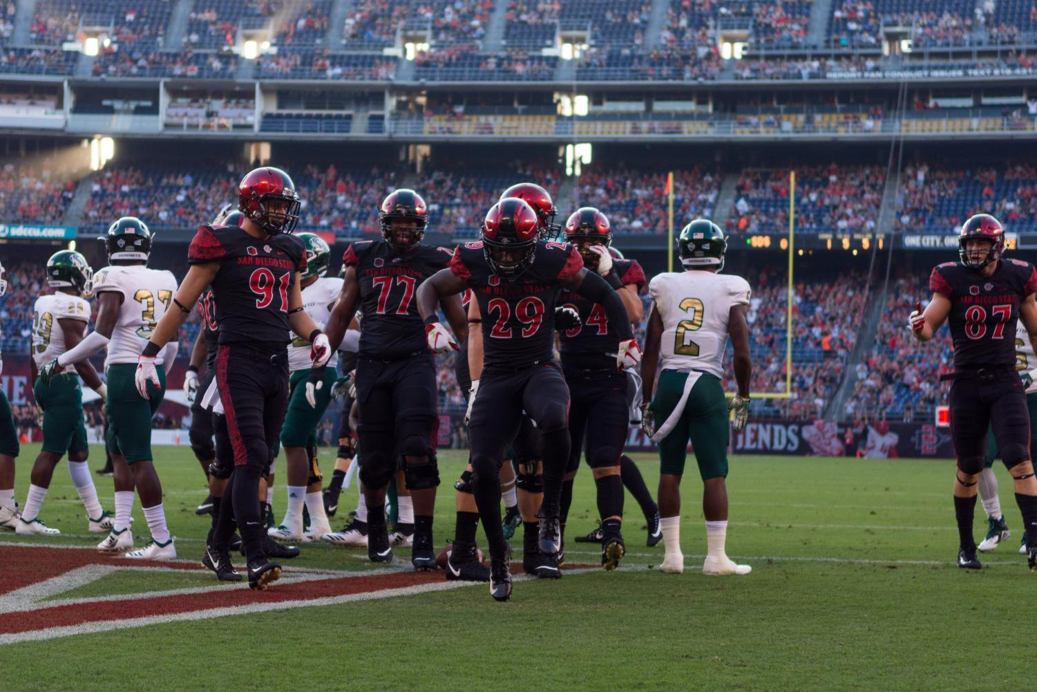 Juwan Washington celebrates after scoring the first of his career-high three touchdowns during the Aztecs 28-14 victory over Sacramento State on Sept. 8 at SDCCU Stadium.