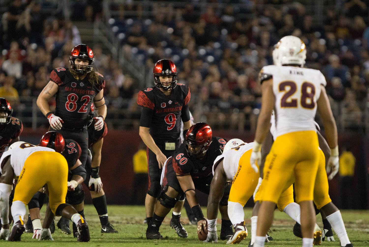 Redshirt junior quarterback Ryan Agnew prepares to take a snap from under center during the Aztecs 28-21 victory over Arizona State on Sept. 15 at SDCCU Stadium.