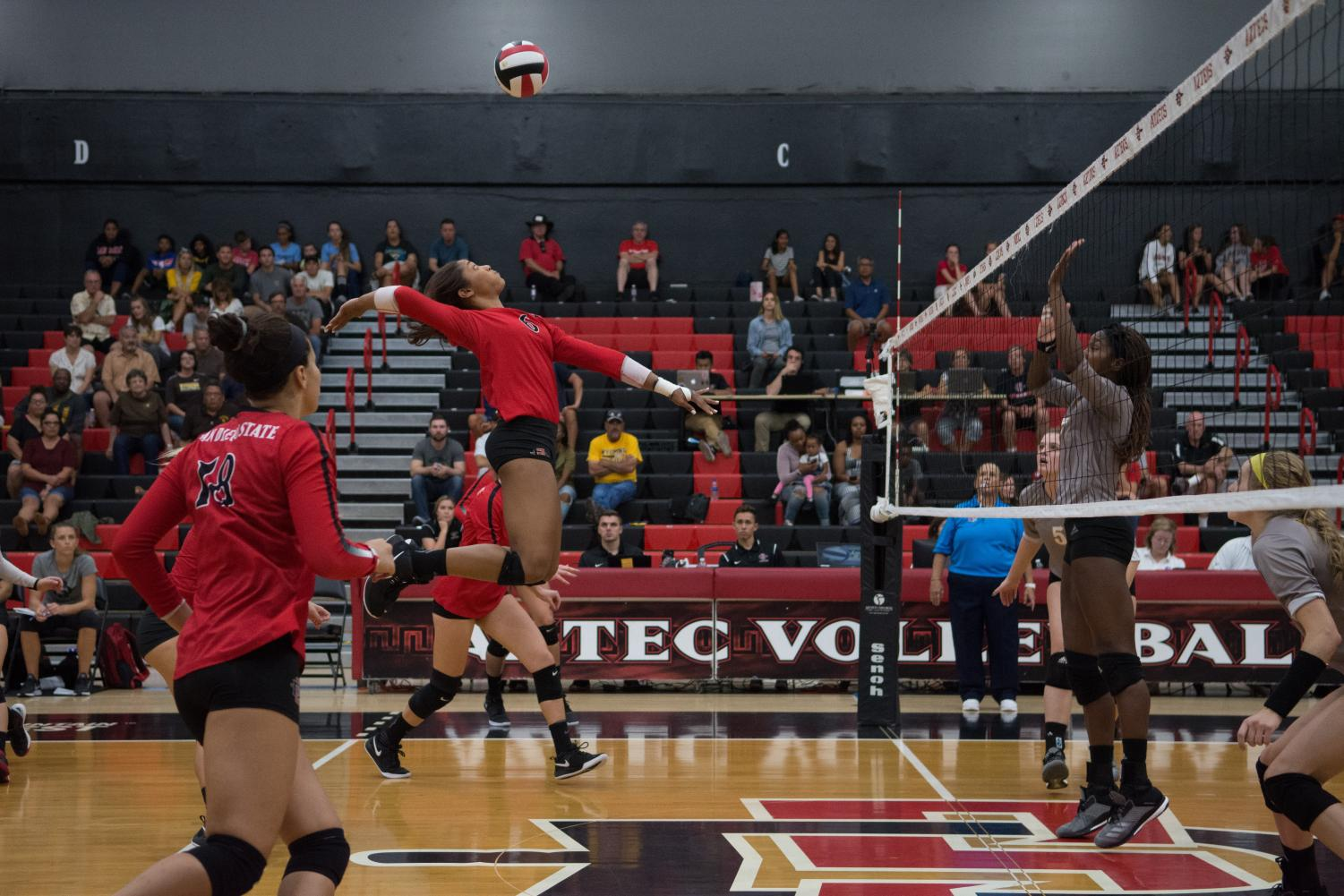 Junior outside hitter Ashlynn Dunbar goes up to spike the ball during the Aztecs five-set victory over Wyoming on Sept. 29 at Peterson Gym. Dunbar set a new career high in the match with 23 kills.