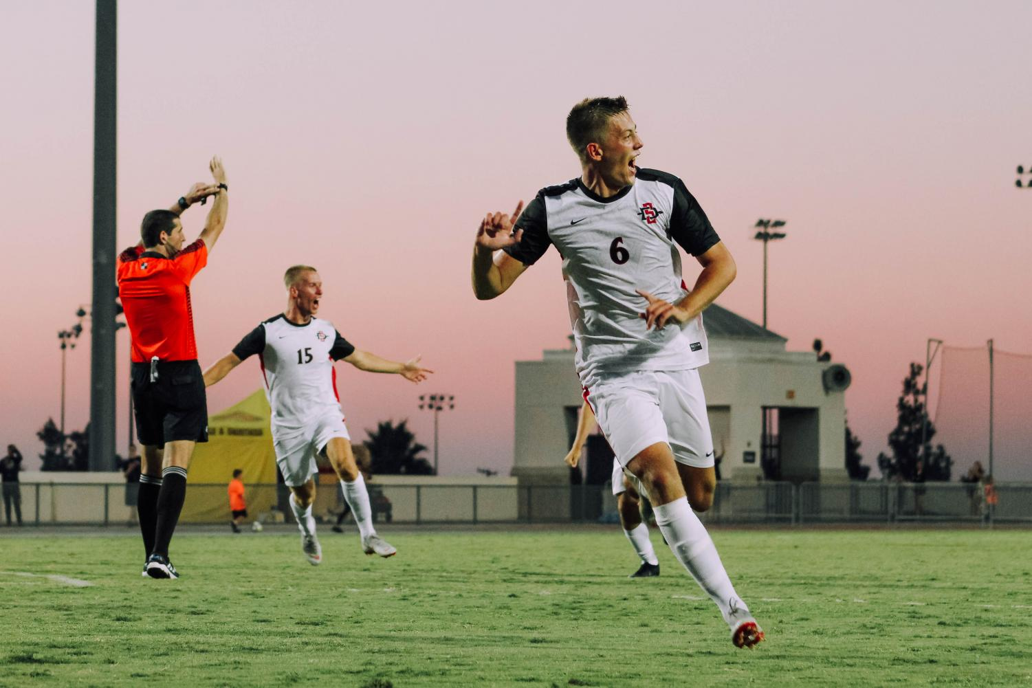 Junior midfeidler Emil Kjellker celebrates after scoring the game-winning goal in overtime of the Aztecs 2-1 victory over UC Irvine on Sept. 9 at the SDSU Sports Deck.