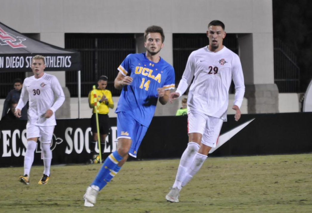 SDSU junior midfielder AJ Valenzuela and UCLA sophomore defender Eric Iloski chase down the ball during UCLA's 2-1 victory over the Aztecs on Oct. 13 at the SDSU Sports Deck.