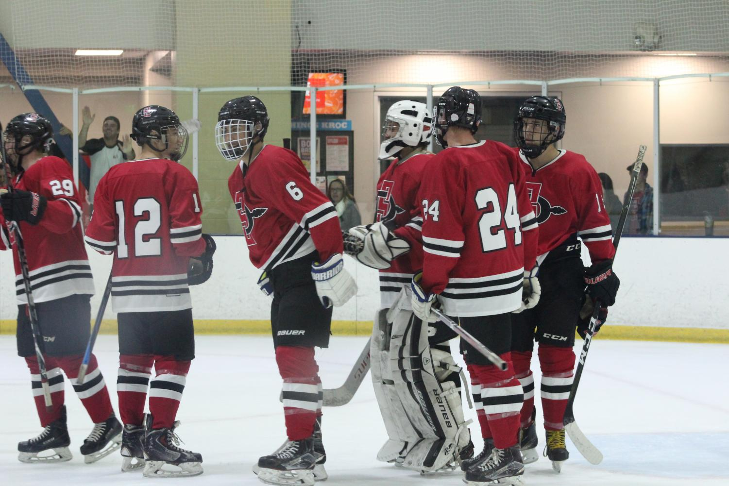 SDSU hockey gathers in a game against UCLA on Oct. 19 at the Joan Kroc Center.