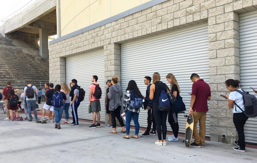 Students+line+up+for+meningitis+vaccinations+outside+of+Viejas+Arena+on+Oct.+8.
