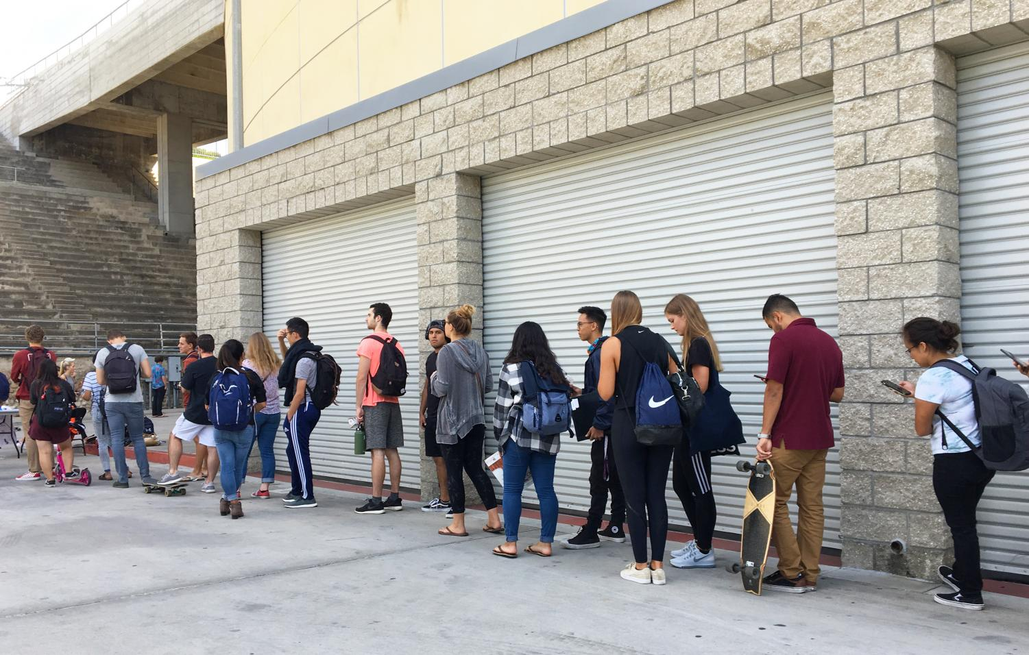 Students line up for meningitis vaccinations outside of Viejas Arena on Oct. 8.