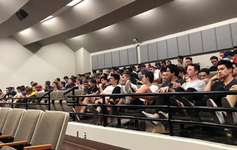 Fraternity members attend the lecture