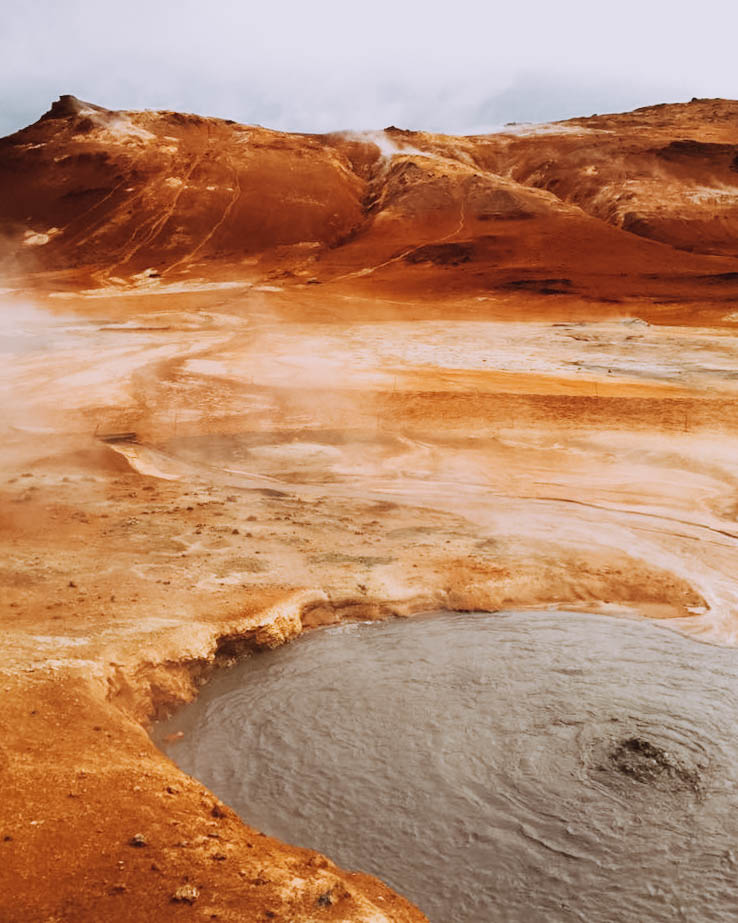Boiling mud is one of several instances of geothermal activity at Námafjall in Iceland.