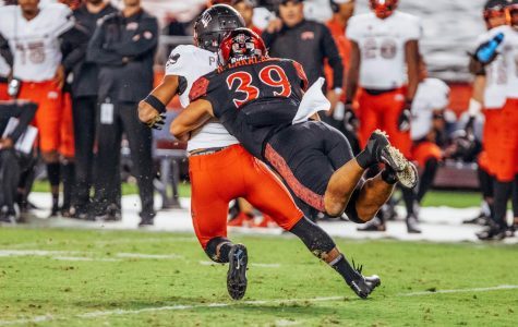 Senior linebacker Ronley Lakalaka dives to tackle UNLV quarterback Max Gilliam during the Aztecs 27-24 loss to the Rebels on Nov. 10 at SDCCU Stadium.