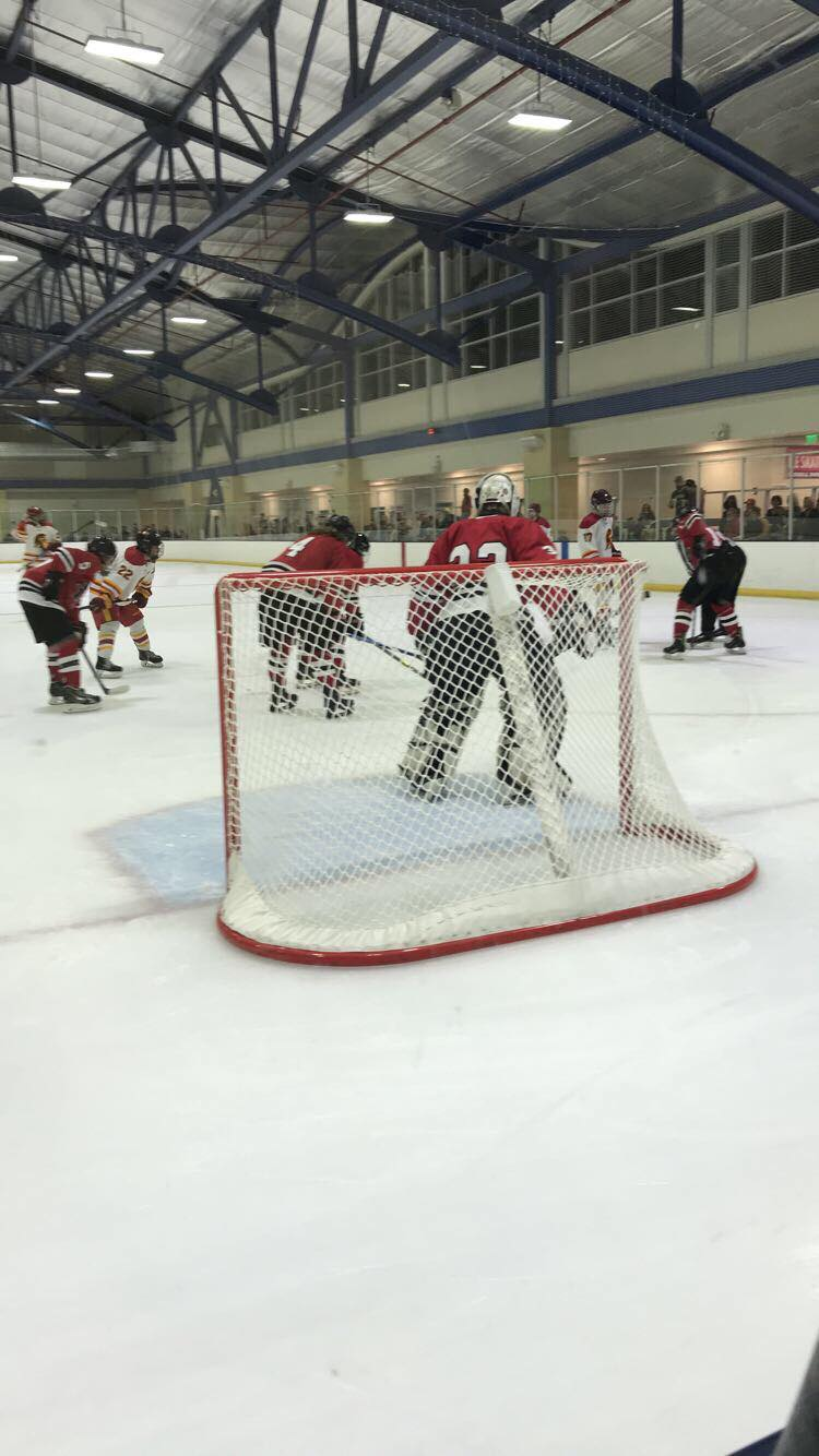 The Aztecs prepare for a faceoff in their zone during a 7-2 victory over USC on Nov. 2 at the Joan Kroc Center.