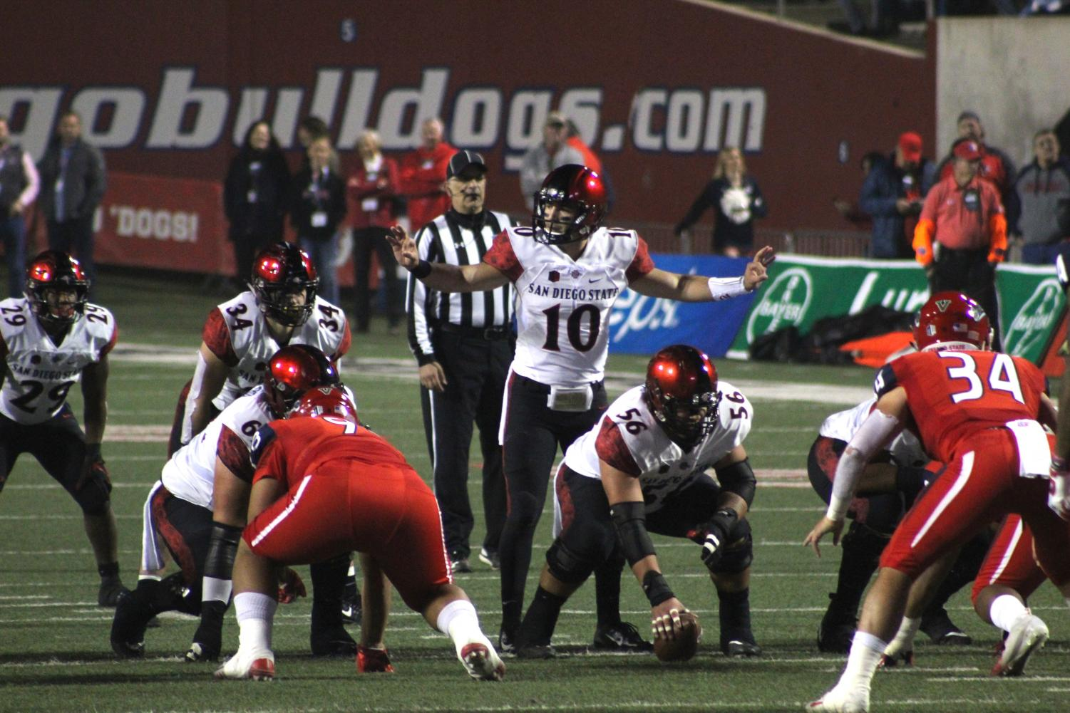 Senior quarterback Christian Chapman prepares for the snap during the Aztecs' 23-14 loss to Fresno State on Nov. 17 at Bulldog Stadium.