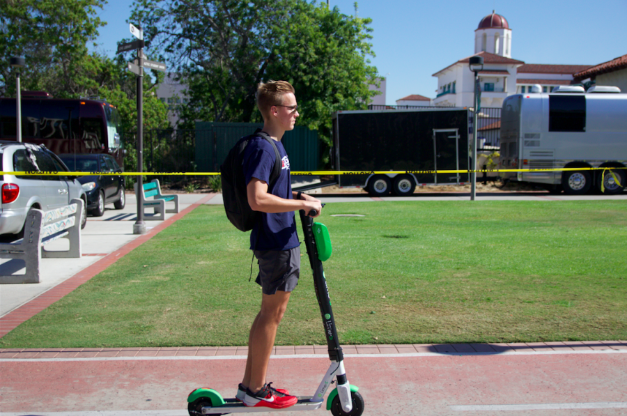 After+getting+his+bike+stolen%2C+aerospace+engineering+freshman+Tanner+Coleman+said+he+now+uses+e-scooters+on+campus+to+ride+back+to+his+dorm+after+working+out+at+the+Aztec+Recreation+Center.+