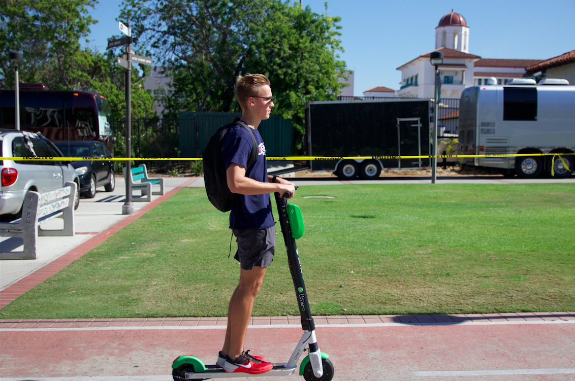 After getting his bike stolen, aerospace engineering freshman Tanner Coleman said he now uses e-scooters on campus to ride back to his dorm after working out at the Aztec Recreation Center.