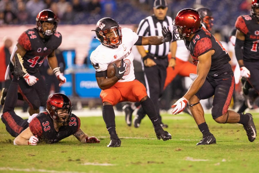SDSU+sophomore+warrior+Tariq+Thompson+attempts+to+make+a+tackle+on+UNLV+senior+running+back+Lexington+Thomas+on+Nov.+10+at+SDCCU+Stadium.